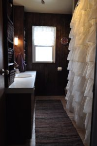 The first look at our new and improved bathroom. Love the rustic look to it.