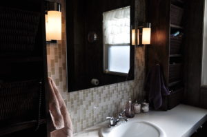 Our vanity with the beautiful tile  behind the mirror.
