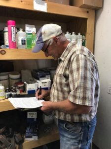 My dad signing the paperwork for the farm. We were officially farm owners.